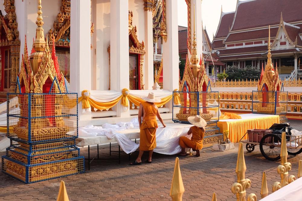 Monks decorating wat