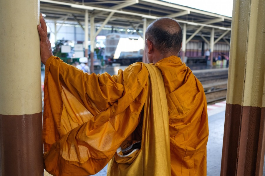 Monk at train station