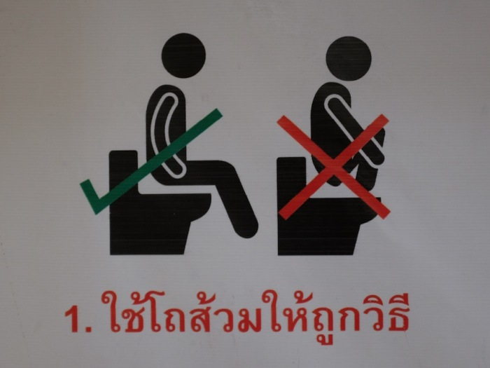 funny thai bathroom sign