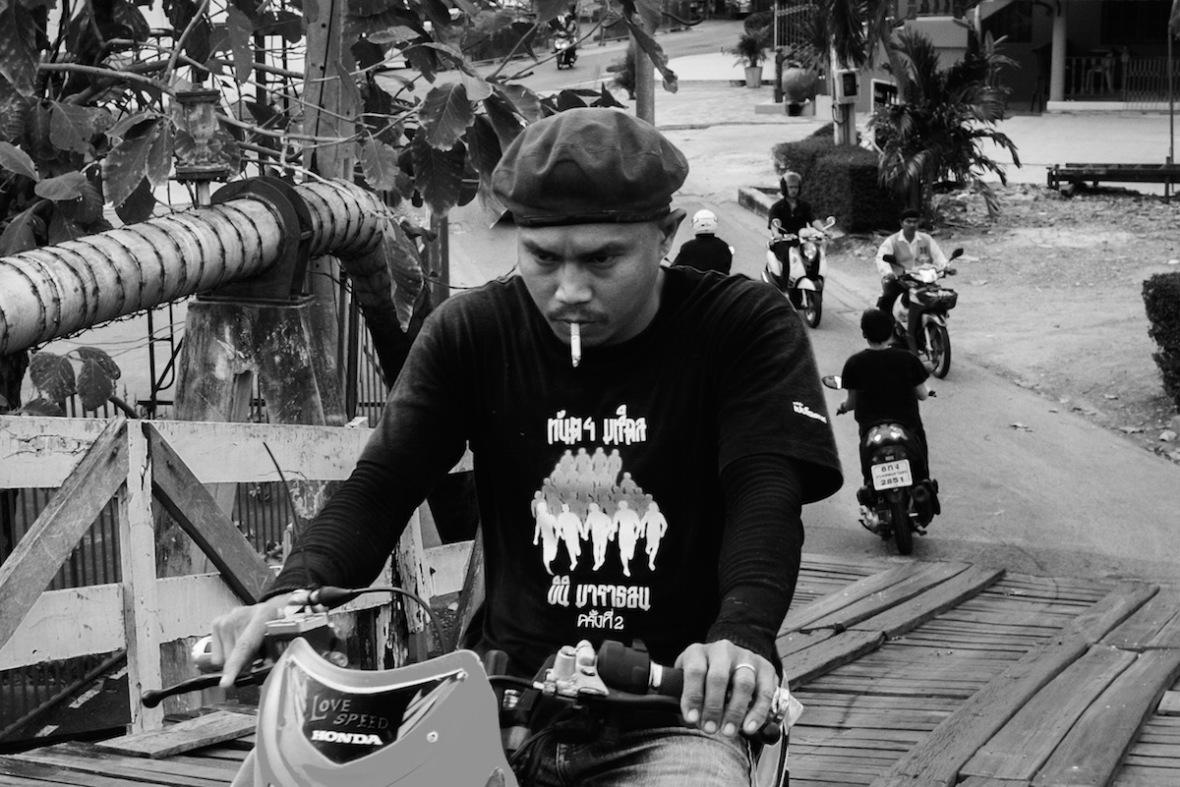 Man on bike smoking