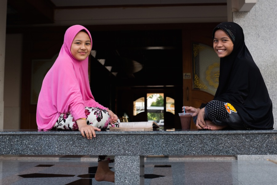 Two girls at a local mosque in Bangkok