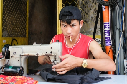 Young guy sewing in Saigon