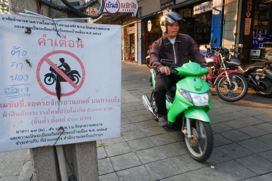 motorbikes on sidewalk Bangkok