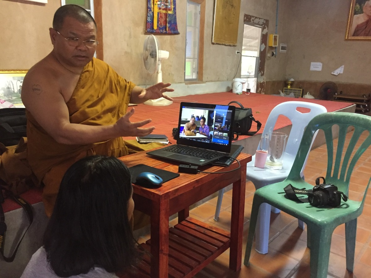Monk teaching photography